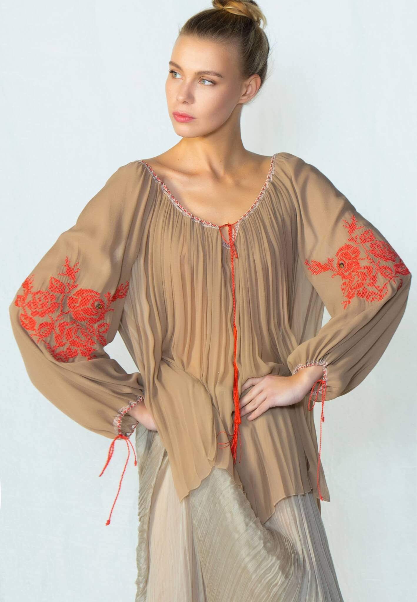 Beige silk blouse with embroidery